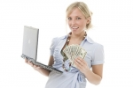BGO Jackpot Winner - Image of woman holding laptop and cas
